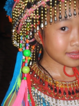 A young girl dancing at the Sunday Night market in Chiang Mai